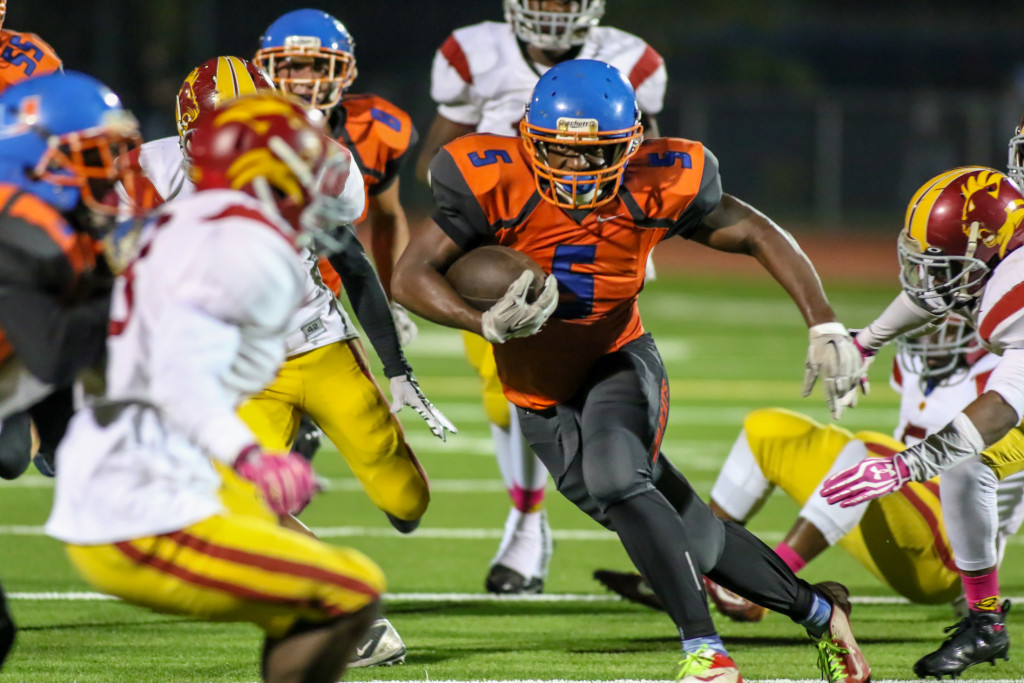 23 Oct 2015: University High School Running back Gabriel McClain (5) getting to the secondary during the Homecoming game against Fairfax. (Photo by Jevone Moore / Full Image 360)