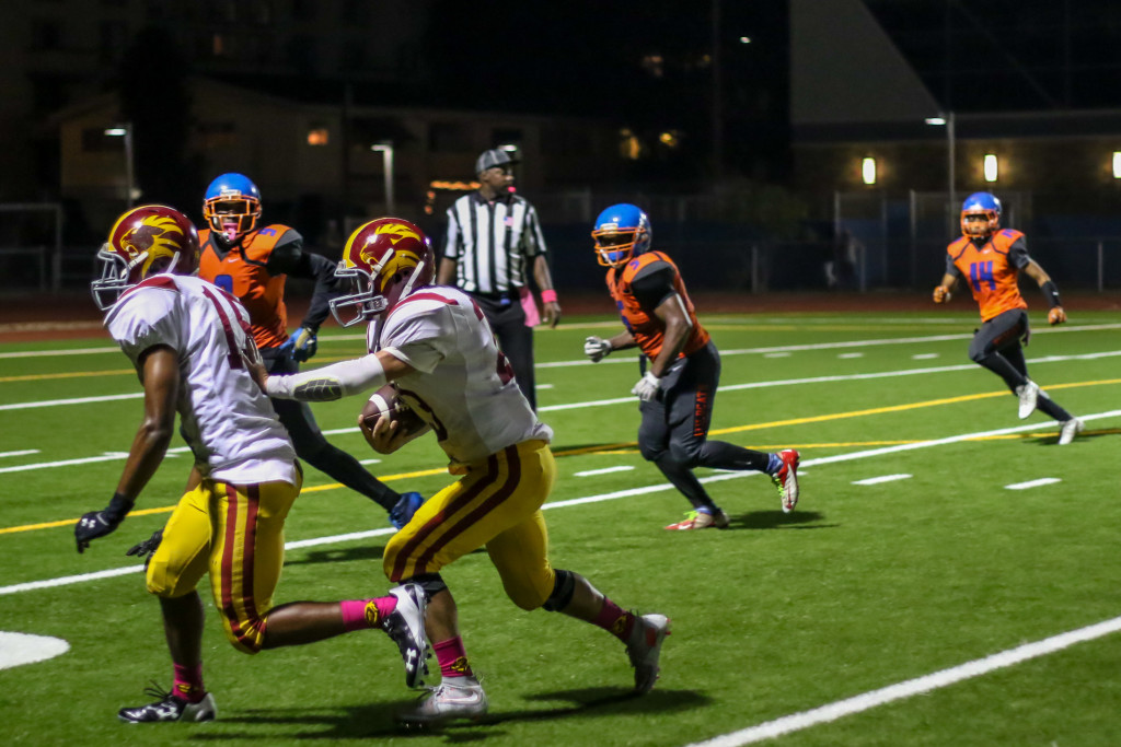 23 Oct 2015: Fairfax High School Running back Ramses Hernandez (23) following his blocking during the Homecoming game against University. (Photo by Jevone Moore / Full Image 360)
