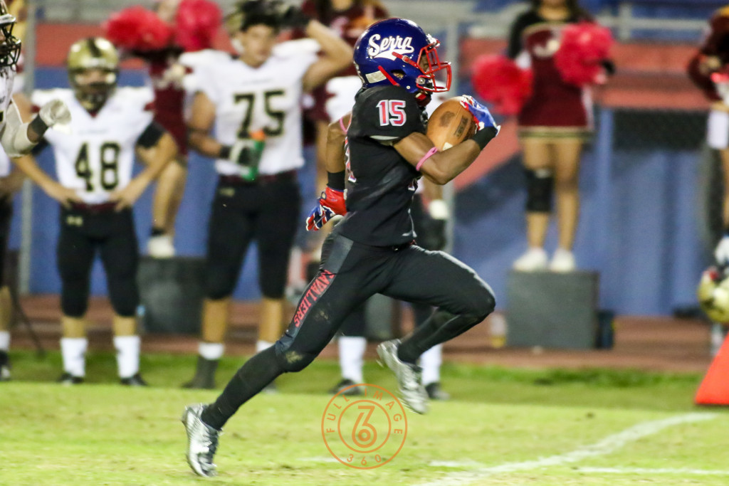 Oct 30, 2015 Serra's Isaiah Diego-Williams (15) in open field on way to a TD run before a flag against Alemany during a game played at Serra High in Gardena, Ca. (Photo by Jevone Moore/Full Image 360)