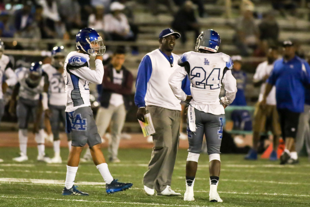16 Oct 2015: LA High  Running Back Justin Rogers (24)  listening to Coach Scott during Homecoming game against Dorsey. (Photo by Jevone Moore / Full Image 360)