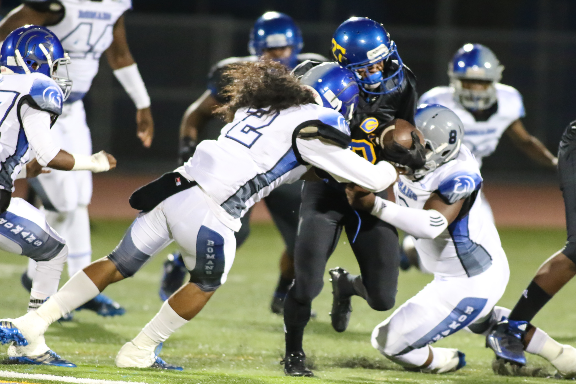 09 Oct. 2015: LA Roman (2) linebacker Elijah Thompson with big hit on Crenshaw Running back (27) Aundre Carter. (Photo By Jevone Moore/Full Image 360