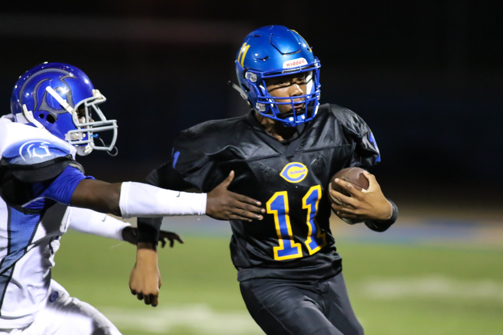 09 Oct. 2015: Crenshaw Quarterback (11) Derrick Darden sliping out of the pocket. (Photo By Jevone Moore/Full Image 360)