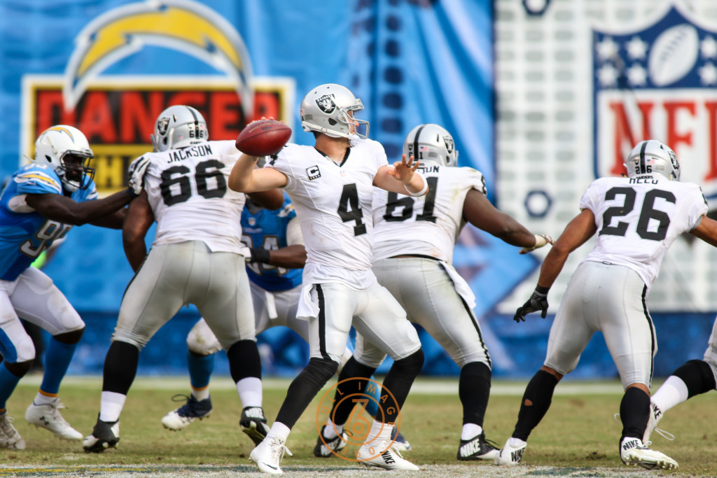 Oct. 25, 2015: Oakland Raiders Quarterback Derek Carr (4) back to pass behind great blocking from the Chargers rush during a game played at Qualcomm Stadium in San Diego, CA. (Photo By Jevone Moore/Full Image 360)