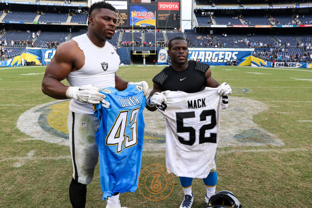 Oct. 25, 2015: Oakland Raiders Defense End Khalil Mack (52) and San Diego Charger Running Back Branden Oliver (43)  exchanging jerseys after a game played at Qualcomm Stadium in San Diego, CA. (Photo By Jevone Moore/Full Image 360)