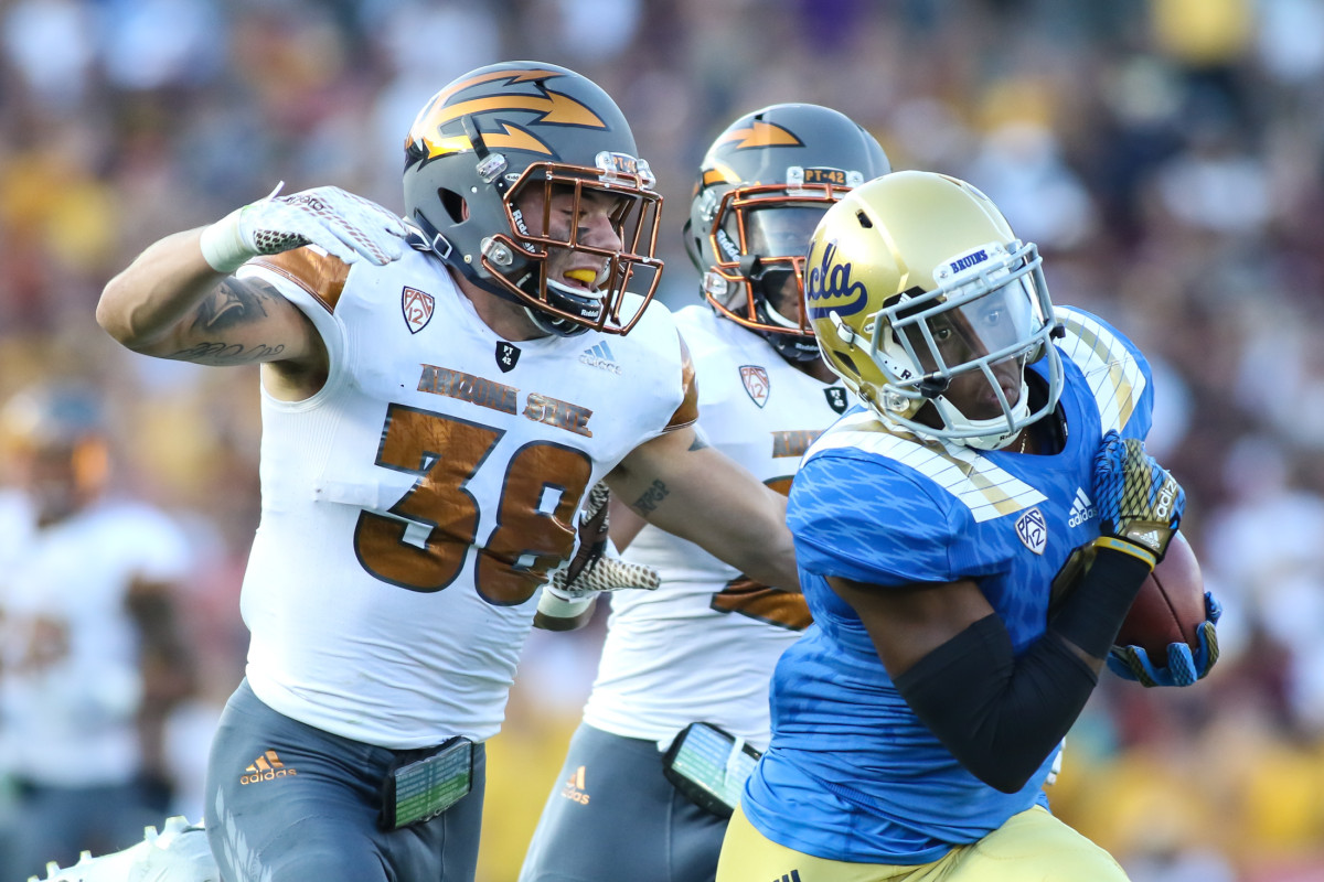 WR Stephen Johnson III on catch with ASU Saftey Jordan Simone on his tail. Photo by Jevone Moore