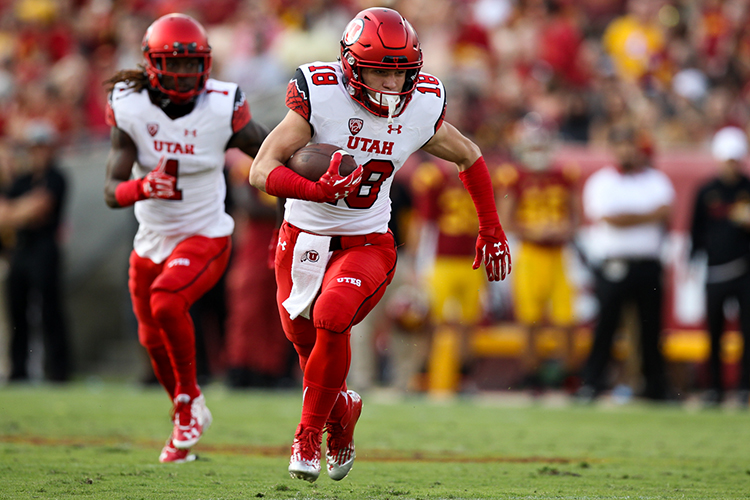 Oct 24, 2015 : Utah Wide receiver   Britain Covey returning a punt during a game verse USC at Los Angeles Memorial Coliseum. (Photo by Jordon Kelly / Jordon Kelly Photography)