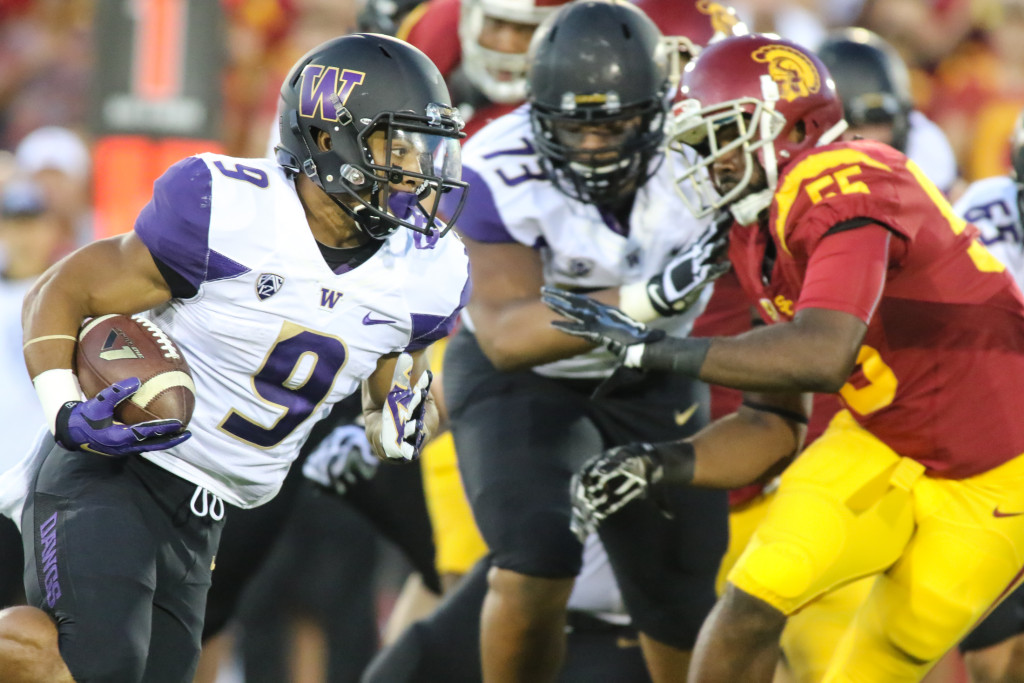 08 Oct. 2015: Washington Huskies running back (9) Myles Gaskin finding a hole during a game against the USC Trojans played at the Los Angeles Memorial Coliseum. (Photo By Jevone Moore/full Image 360)