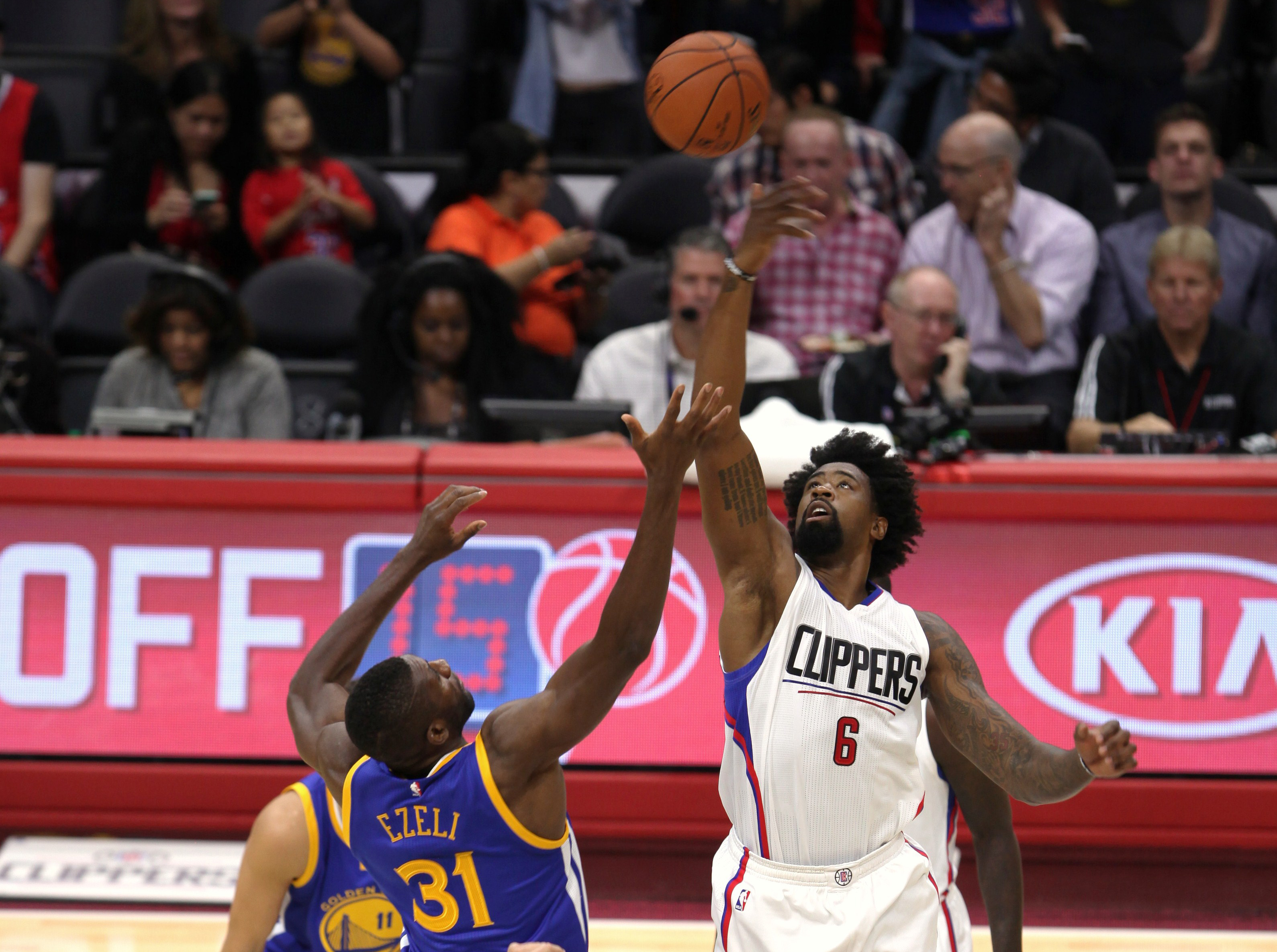 Oct. 20, 2015 - Los Angeles, CA, USA - The Los Angeles Clippers DeAndre Jordan (6) goes up for opening tip against the Golden state Warrior Festus Ezeli (31) during a preseason playing at Staples Center in Los Angeles on Tuesday, Oct. 20, 2015 (Photo by William Jaye Johnson)