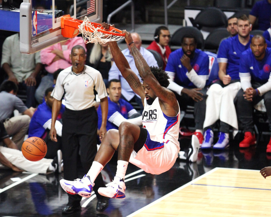 Oct. 20, 2015 - Los Angeles, CA, USA - The Los Angeles Clippers DeAndre Jordan (6) rocking the rim for a dunk against the Golden state Warriors during a preseason playing at Staples Center in Los Angeles on Tuesday, Oct. 20, 2015 (Photo by William Jaye Johnson)