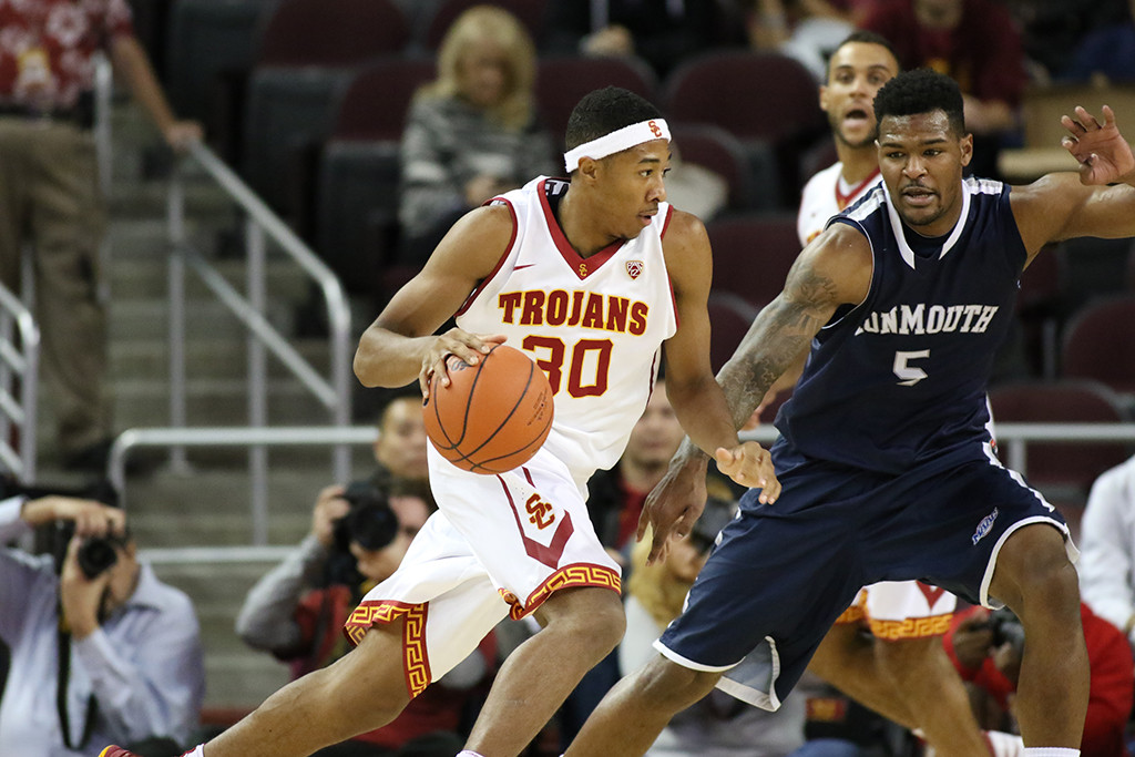 Nov 16, 2015 USC Guard Elijah Stewart make a drive on Monmouth Guard Deon Jones during the Monmouth Hawks vs USC Tojans Men's basketball game at the Galen Center in Los Angeles, Ca.  (Photo by Jevone Moore/Full Image 360)