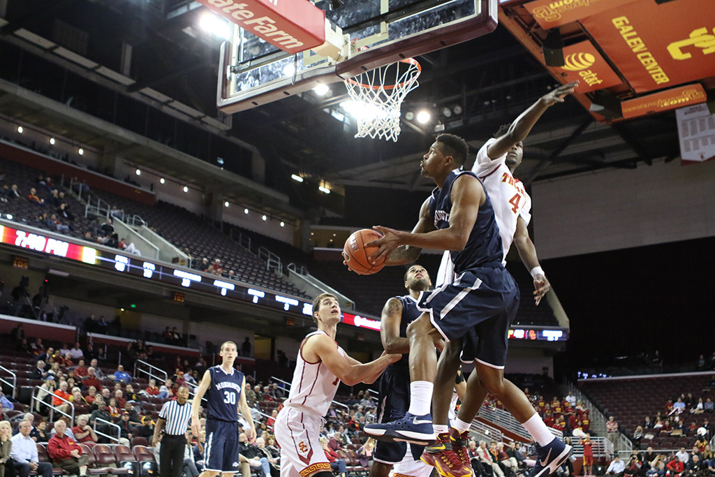 Nov 16, 2015 Monmouth Guard Deon Jones on show and under move to basket with and AND1 during the Monmouth Hawks vs USC Tojans Men's basketball game at the Galen Center in Los Angeles, Ca.  (Photo by Jevone Moore/Full Image 360)