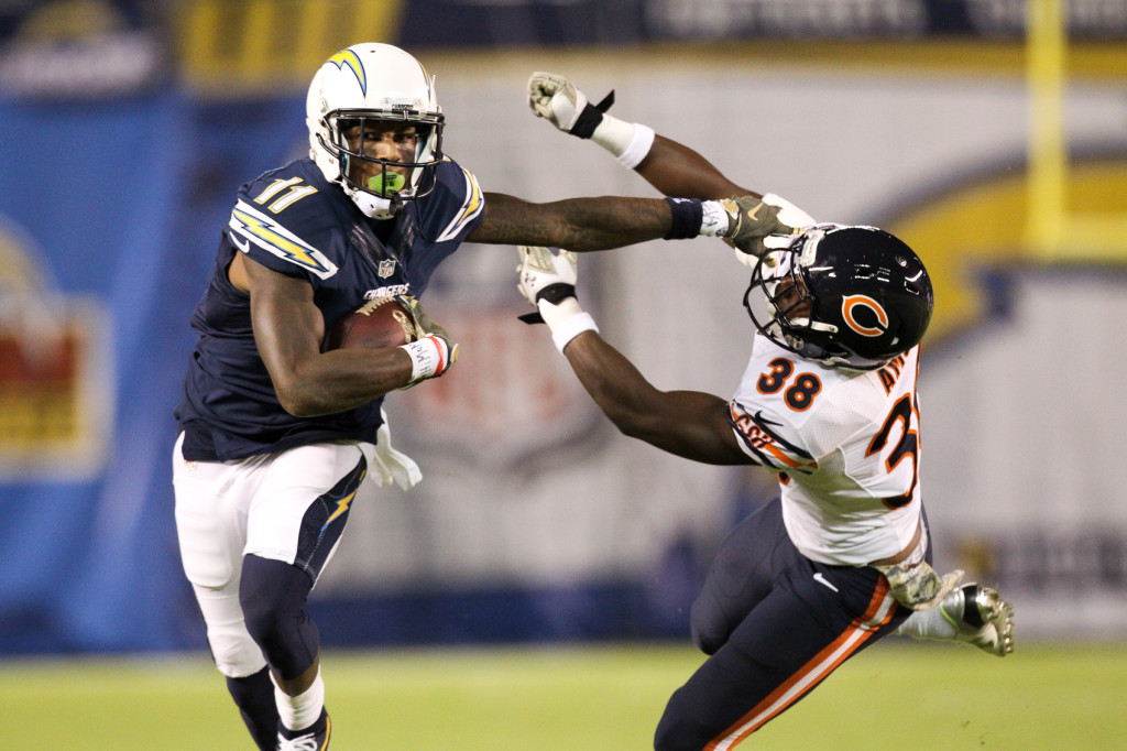 Nov 9: Chargers receiver (11) Steve Johnson stiff arming Bears defender during the Chicago Bears vs San Diego Chargers (Photo by Jordon Kelly)