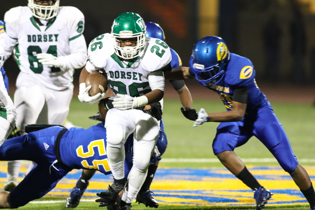 Nov 6 Dorsey running back Devin Mangrum (26) busting through during the game Dorsey Dons vs Crenshaw Cougars(Photo by Jevone Moore/Full Image 360)
