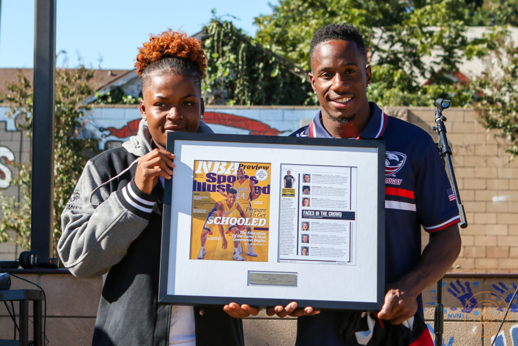 Nov 13:USA Rugby player Carlin Isle & Nia Toliver  with her Sports Illustrated award at View Park High School in Los Angeles, Ca. (Photo by Jevone Moore/Full Image 360)