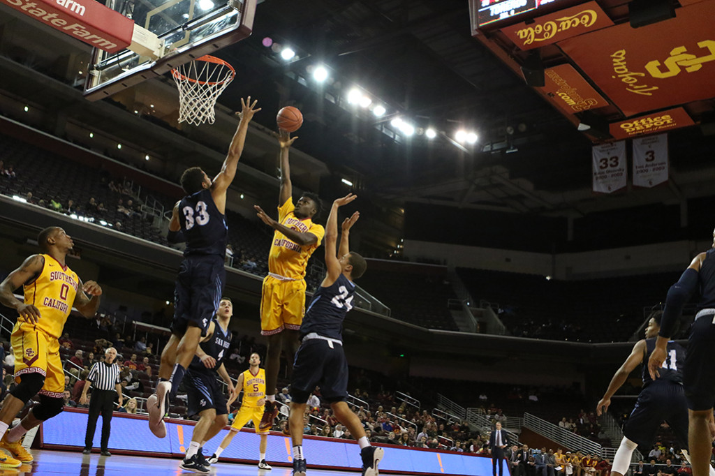 Nov 13 USC Men's Basketball true freshman (4) Chimezie Metu playing above the rim against San Diego defenders at San Diego vs USC Basketball game at Galen Center in Los Angeles, Ca. (Photo by Jevone Moore/Full Image 360)