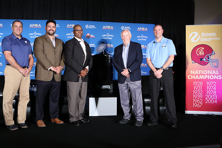 Nov 5: Amway Coaches Poll Trophy with Dan Groen, Shawn Kody (LB USC), Sam Cunningham (RB USC), Crystal Football, Coach John Robinson, Amway Brand Manager Andy Gamm on stage in Founder's Club at USC Galen Center in Los Angeles, Ca. (Photo by Jevone Moore/Full Image 360)