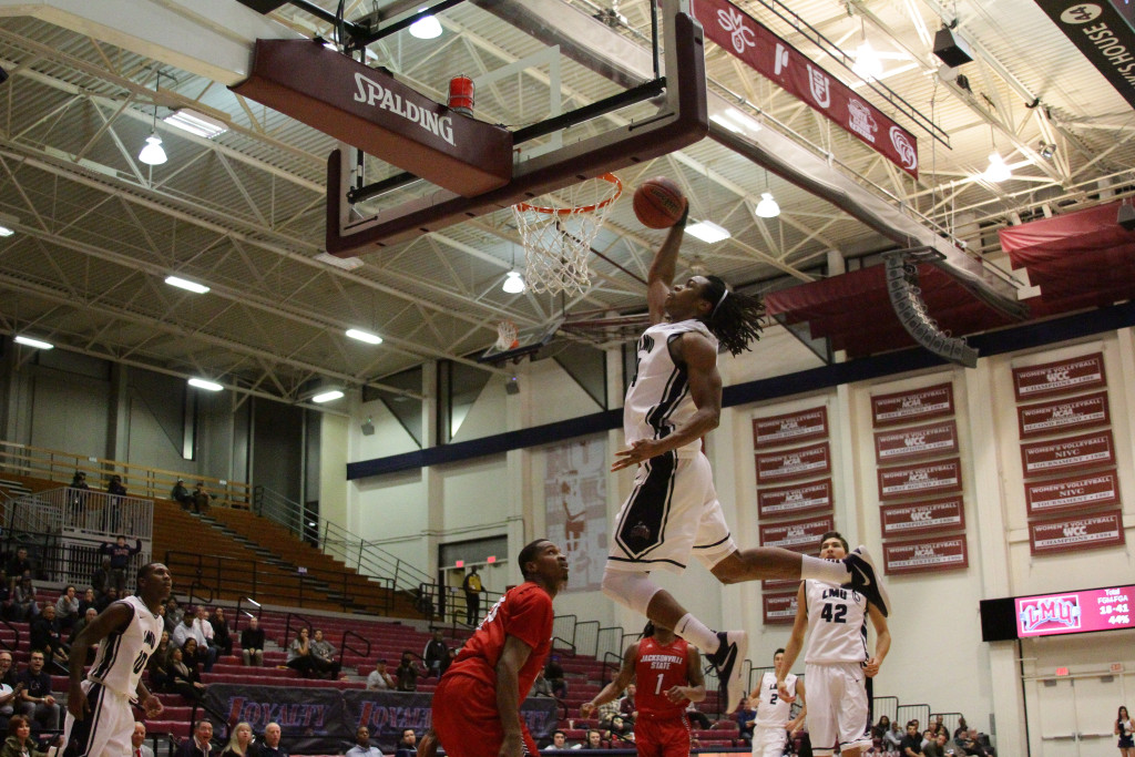 Loyola Marymount Lions forward Adom Jacko (4) on moster dunk in the Jacksonville State vs Loyola Marymount Men's Basketball in the Second half at the Gersten Pavilion on Dec. 18th, 2015. (Photo by  Michael Ewing/fi360 News)