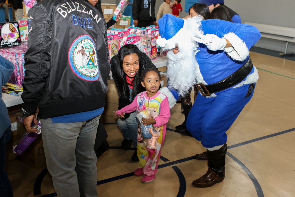 Phi Beta Sigma Frat. Inc Toys for Watts at Jordan Downs on Dec. 19th, 2015. (Photo by Jevone Moore/fi360 News)