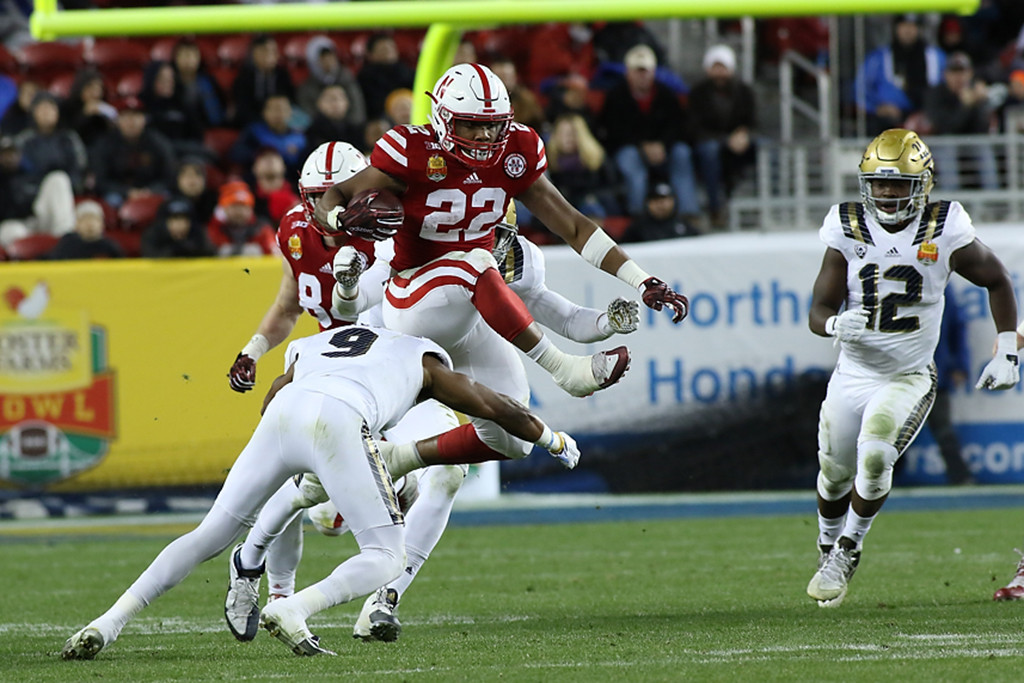 Nebraska Cornhuskers running back Devine Ozigbo (22) hurdling UCLA Bruins defensive back Marcus Rios (9) in the second half during the Foster Farms Bowl between the UCLA Bruins and the Nebraska Cornhuskers on Saturday Dec 26th, 2015. (Photo by Jevone Moore/fi360 News)