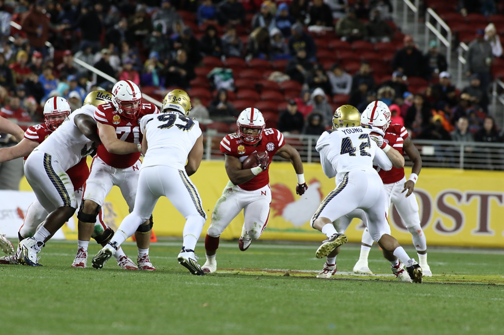 Nebraska Cornhuskers running back Devine Ozigbo (22) finding daylight during the Foster Farms Bowl between the UCLA Bruins and the Nebraska Cornhuskers on Saturday Dec 26th, 2015. (Photo by Jevone Moore/fi360 News)