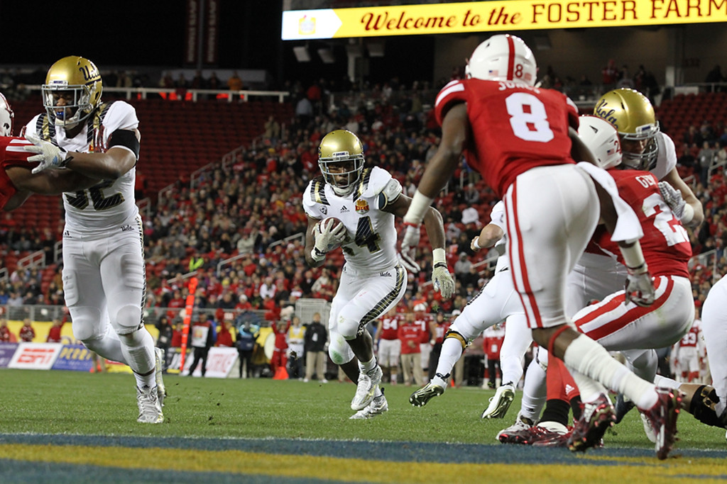 UCLA Bruins running back Paul Perkins (24) on way to touchdown during the Foster Farms Bowl between the UCLA Bruins and the Nebraska Cornhuskers on Saturday Dec 26th, 2015. (Photo by Jevone Moore/fi360 News)