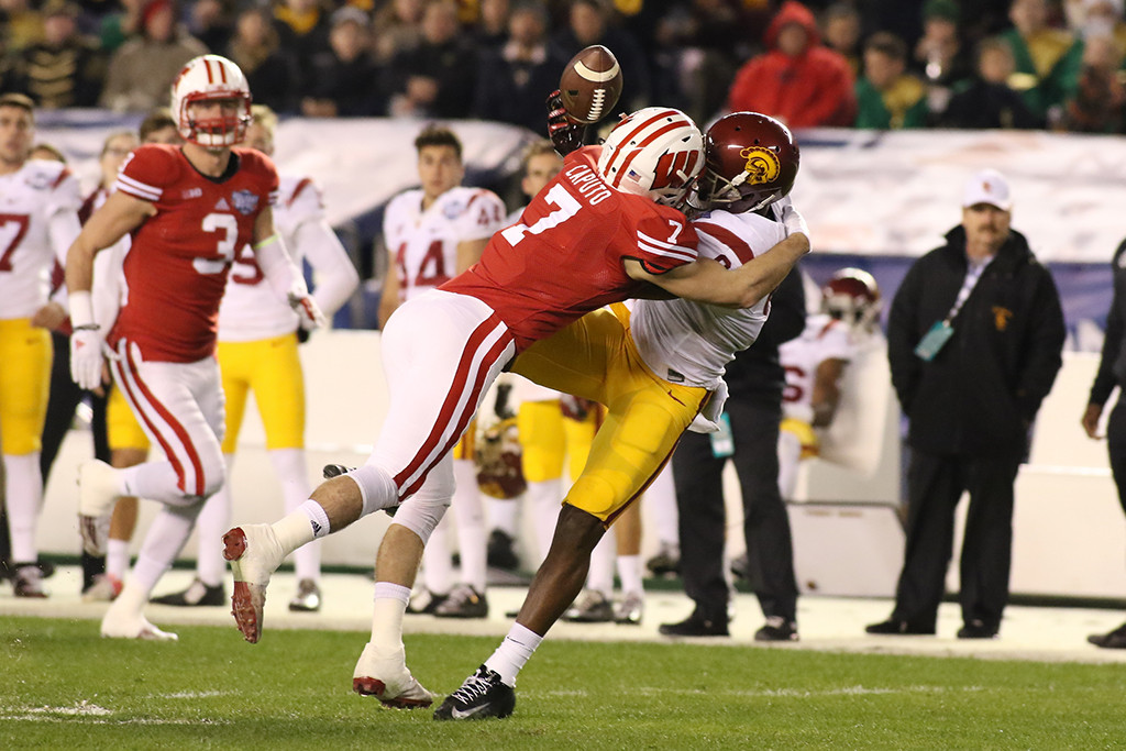 Wisconsin Badgers safety Michael Caputo (7) with tight coverage on USC Trojans wide receiver JuJu Smith-Schuster (9) during the National Funding Holiday Bowl between the USC Trojans vs Wisconsin Badgers on Wednesday Dec 30th, 2015. (Photo by Jevone Moore/fi360 News)