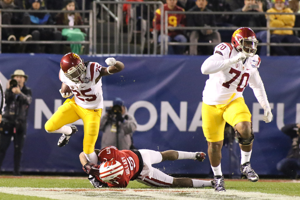 USC Trojans running back Ronald Jones II (25) breaking the tackle of Wisconsin Badgers cornerback Darius Hillary (5)during the National Funding Holiday Bowl between the USC Trojans vs Wisconsin Badgers on Wednesday Dec 30th, 2015. (Photo by Jevone Moore/fi360 News)
