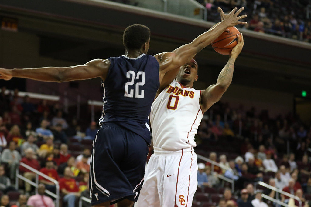USC Trojans forward Darion Clark (0) showing off his hand time over Yale Bulldogs forward Justin Sears (22) in the first half of the Pac-12 Men's Basketball USC Trojans vs Yale Bulldogs at the Galen Center on Dec. 13th, 2015. (Photo by Jevone Moore/Full Image 360)