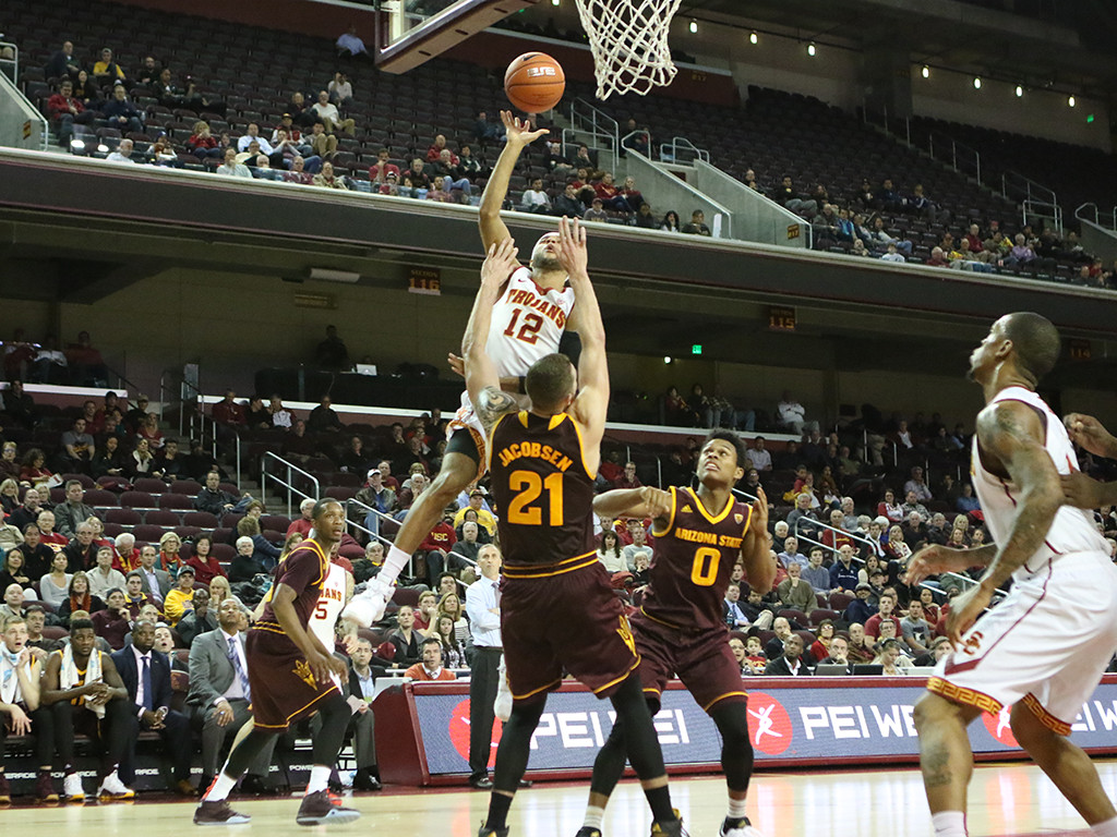 USC Trojans guard Julian Jacobs (12) on a layup over Arizona State Sun Devils forward Eric Jacobsen (21) in the first half during the college basketball game between the Arizona State Sun Devils and the USC Trojans at Galen Center in Los Angeles, CA. (Photo by Jevone Moore/Full Image 360)