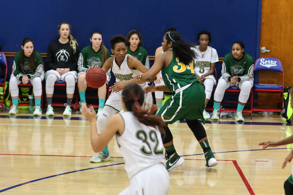 High School Basketball    Lady Jackrabbits Jasmine Jones (34) applying pressure on Lakeside forward Mya Victor (00)MLK Cavalier Extravaganza  between the Lakeside Lancers and the Long Beach Poly Lady Jackrabbits at JSerra High School in Gardena, CA. (Photo by  Jevone Moore/Full Image 360)