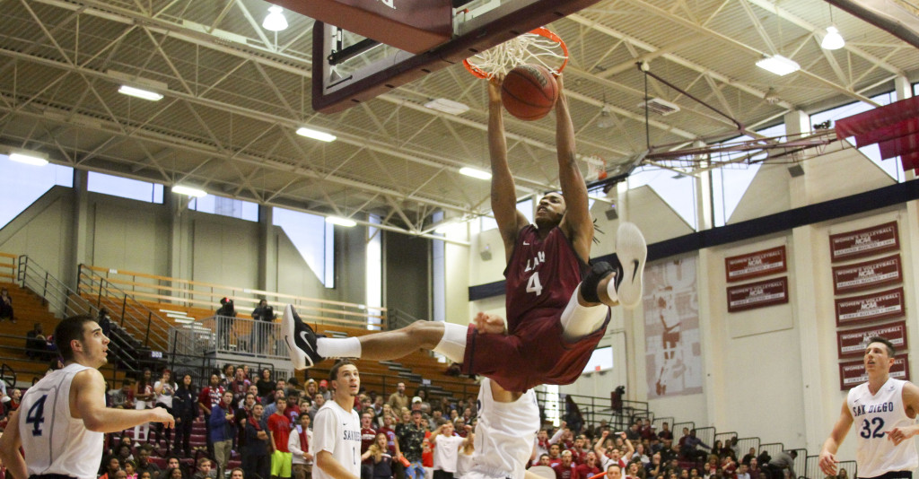 LMU Adom Jacko slamming one home in the San Diego vs LMU game action at the Gersten Pavilion on Jan 23th, 2016. (Photo by Michael Ewing/fi360 News)