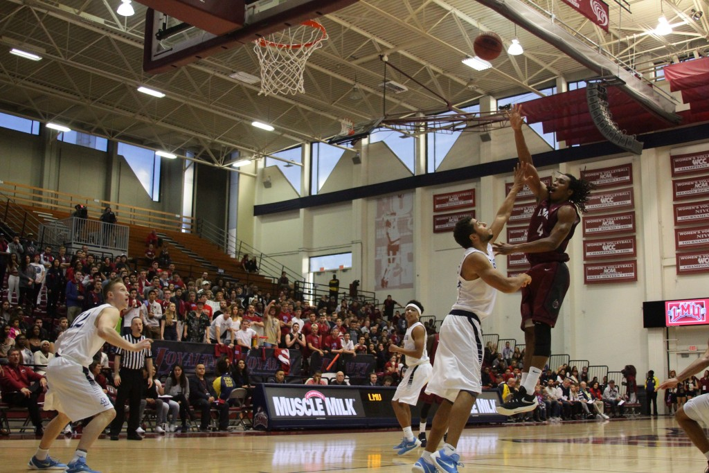 LMU Adom Jacko with a jump shot in the San Diego vs LMU game action at the Gersten Pavilion on Jan 23th, 2016. (Photo by Michael Ewing/fi360 News)