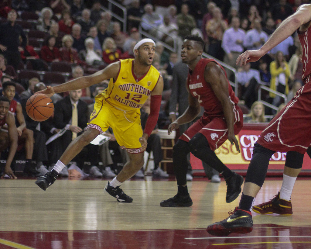 USC Julian Jacobs looking to go by WSU Ike Iroegbu defending during second half of the Washington State vs USC game at the Galen Center in Los Angeles, CA. (Photo by Michael Ewing/fi360 News)