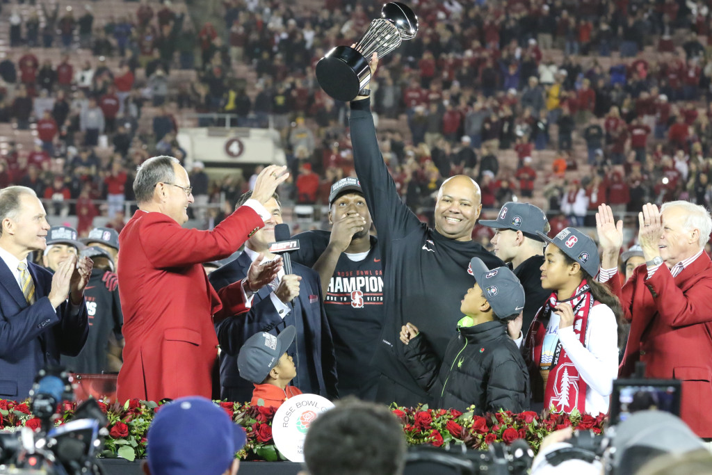 Stanford Cardinal head coach David Shaw hosting the Championship trophy at the 102nd Rose Bowl Game Stanford Cardinals vs Iowa Hawkeyes 2016. (Photo by Jevone Moore/fi360 News)