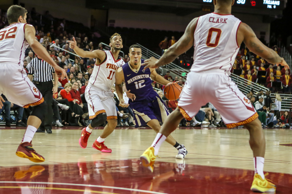 Washington Huskies guard Andrew Andrews (12) getting trapped in the lane during the college basketball game between the Washington Huskies and the USC Trojans at Galen Center in Los Angeles, CA. (Photo by Jevone Moore/Full Image 360)
