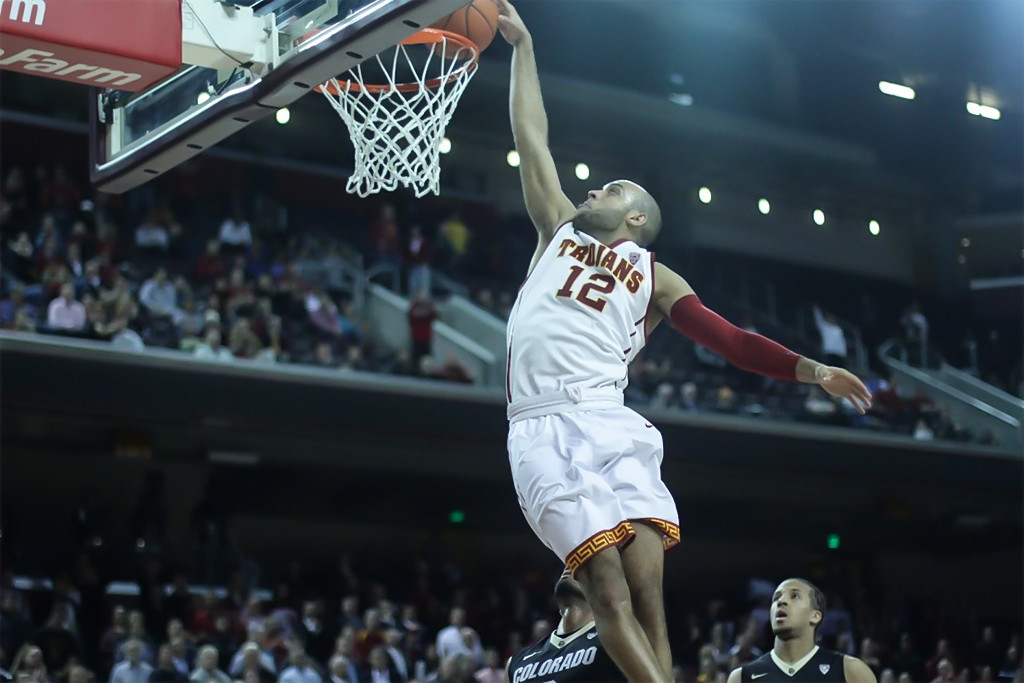 USC Julian Jacobs dunking on fast break during Colorado vs USC game at the Galen Center in Los Angeles, CA. (Photo by Michael Ewing/fi360 News)