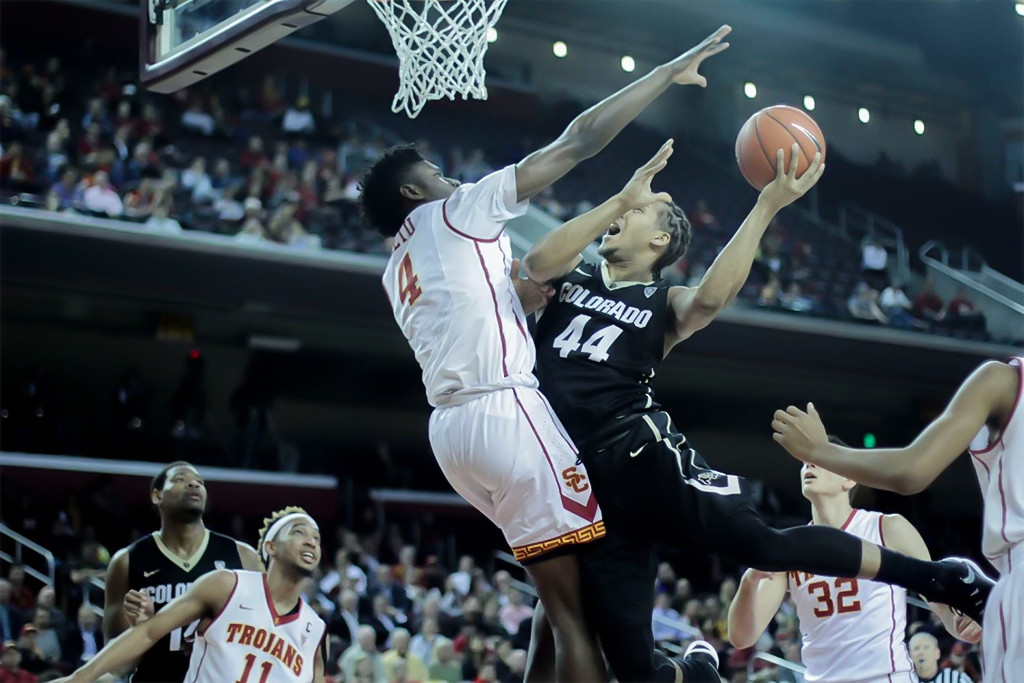 USC Chimezie Metu protecting the rim from Josh Fortune during Colorado vs USC game at the Galen Center in Los Angeles, CA. (Photo by Michael Ewing/fi360 News)
