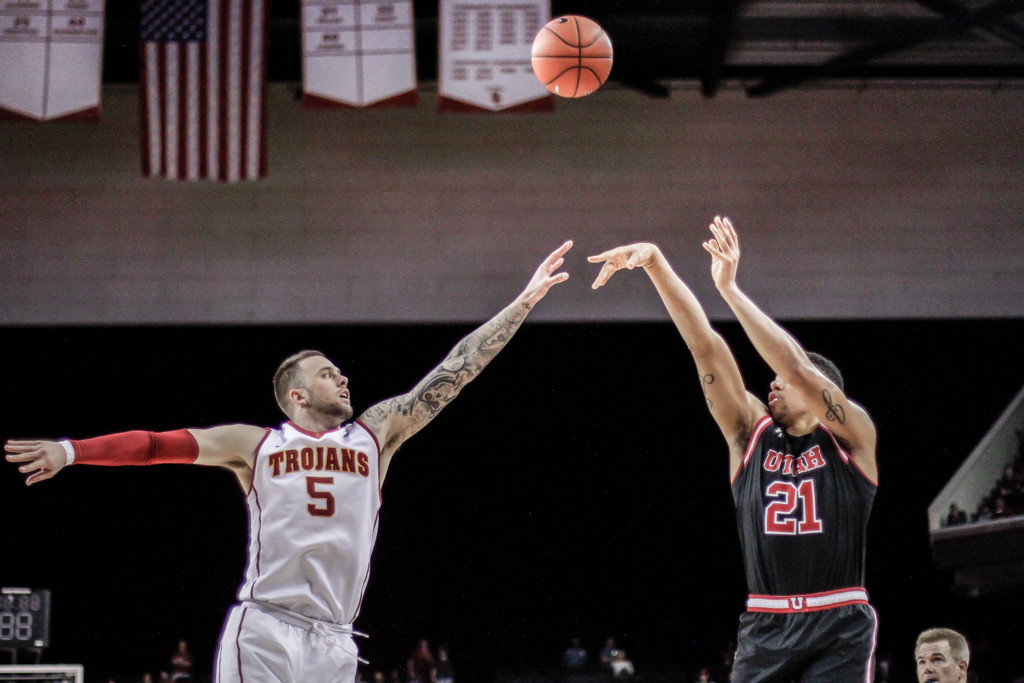 Utah Jordan Loveridge shooting a jumper over Katin Reinhardt during Utah vs USC game at the Galen Center in Los Angeles, CA. (Photo by Michael Ewing / fi360 News)