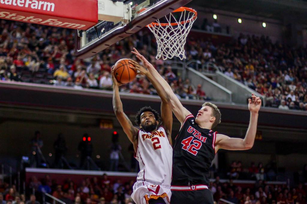 USC Malik Marquetti battling in the paint with Utah's Jakob Poeltl during Utah vs USC game at the Galen Center in Los Angeles, CA. (Photo by Michael Ewing / fi360 News)