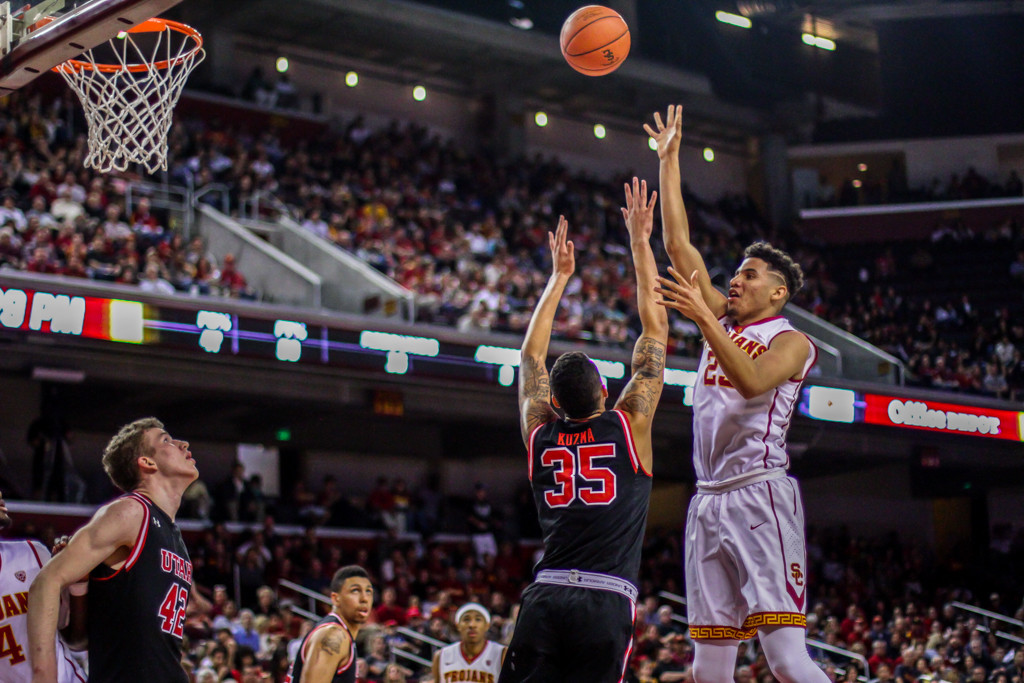 USC Bennie Boatwright with floater in lane on Utah Jayce Johnson during Utah vs USC game at the Galen Center in Los Angeles, CA. (Photo by Michael Ewing / fi360 News)