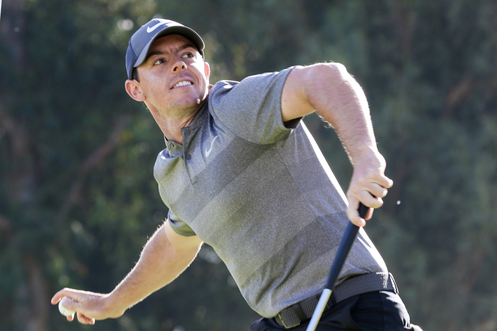 February 21, 2016: Rory Mcilory toss his ball into crowd after his 18th hole birdie during the final round action of PGA Golf during the Northern Trust Open at The Riviera Country Club in Los Angeles, CA. (Photo by  Jevone Moore/Full Image 360)