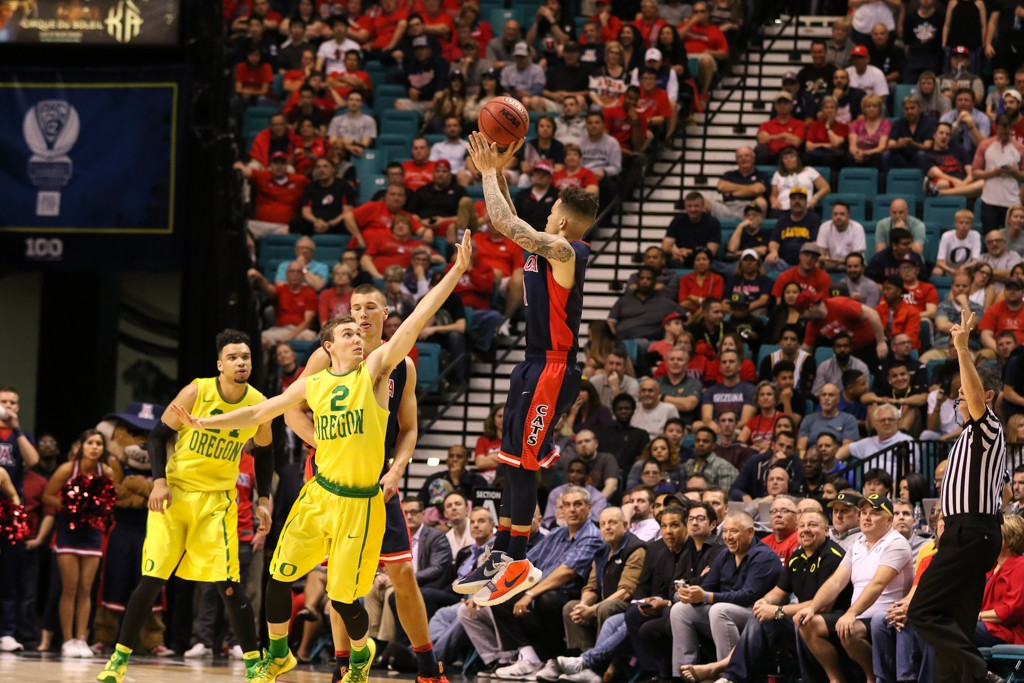 NCAA College Basketball game Gabe York dropping a three during overtime of the 2016 PAC-12 Basketball Tournament semifinalsl game between the Oregon Ducks and the Arizona Wildcats at MGM Grand Las Vegas, NV. (Photo by Jevone Moore/Full Image 360)