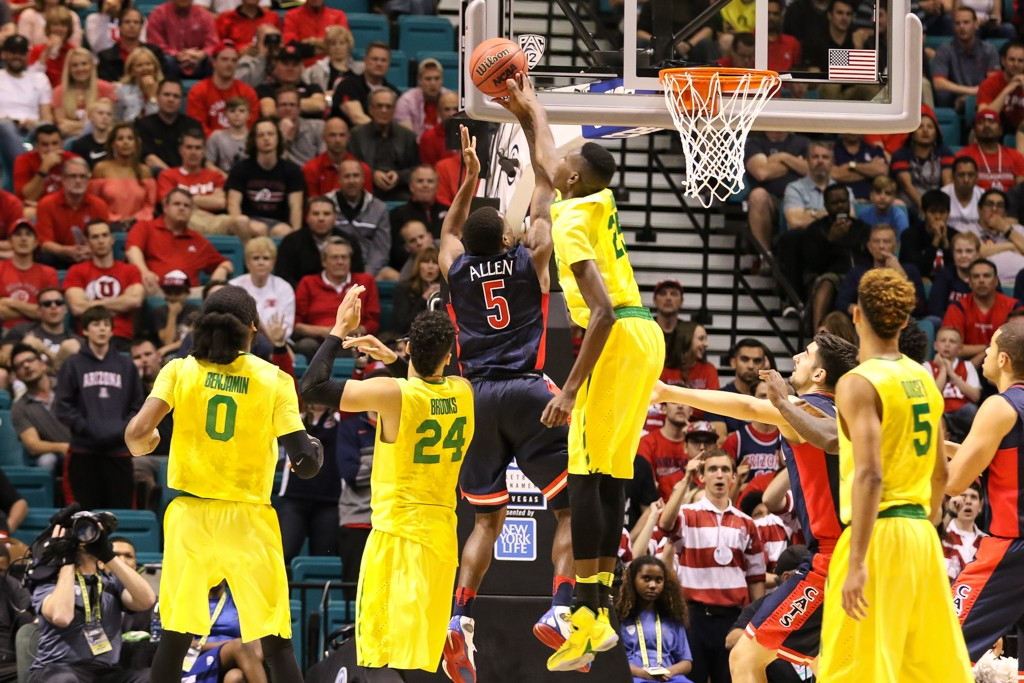 NCAA College Basketball game Chris Boucher playing defense above the rim during the 2016 PAC-12 Basketball Tournament semifinalsl game between the Oregon Ducks and the Arizona Wildcats at MGM Grand Las Vegas, NV. (Photo by Jevone Moore/Full Image 360)