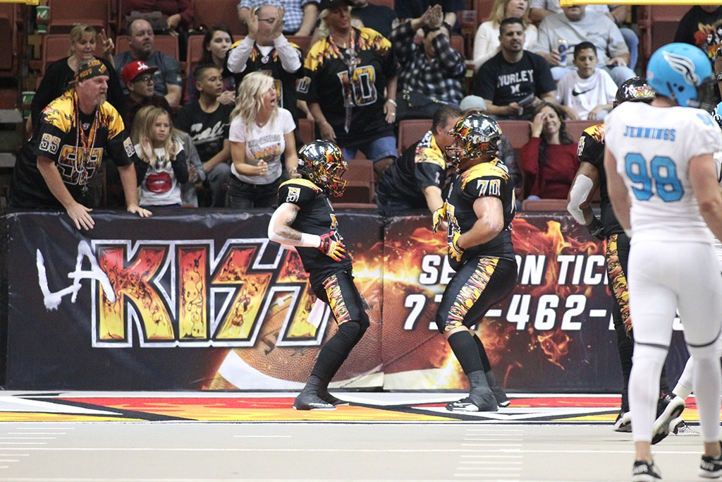 LA KISS Celebrate after a touchdown in game verse Philadelphia Soul at the Honda Center in Anaheim, Ca. (Photo by Jordon Kelly / fi360 News)