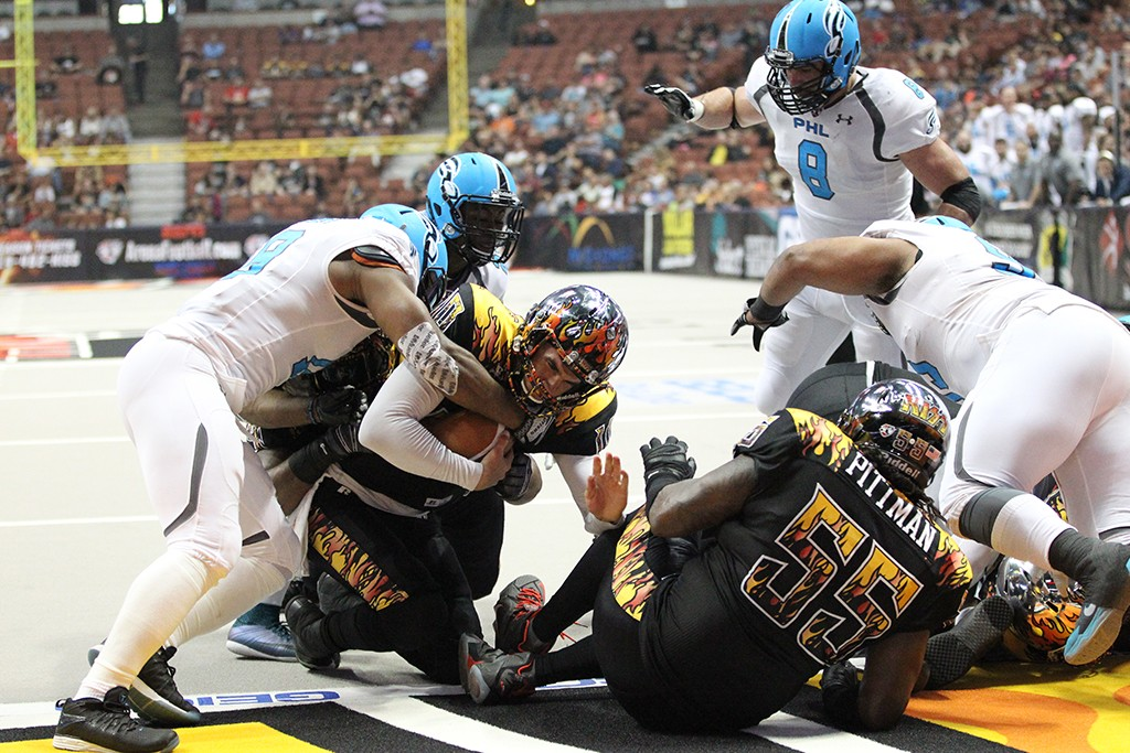 LA KISS QB Nathan Stanley willing himself to the Goal line to score a touchdown, in Anaheim, Ca. (Photo by Jordon Kelly / fi360 News)