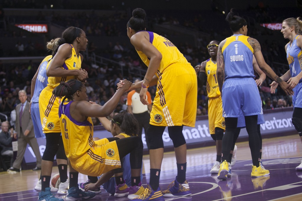 WNBA 2016: Chelsea Gray being helped up by her teammates during Chicago Sky vs Los Angeles Sparks game at Staples Center in Los Angeles, Ca on June 14, 2016. (Photo by Curtis J. Moore / fi360 News)