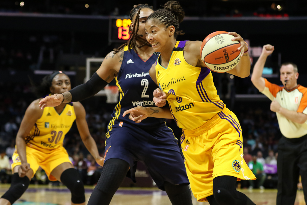 Candace Parker driving to the basket on Eriana Larkins during Indiana Fever vs Los Angeles Sparks game at Staples Center in Los Angeles, Ca on July 6, 2016. (Photo by Jevone Moore/Full Image 360)