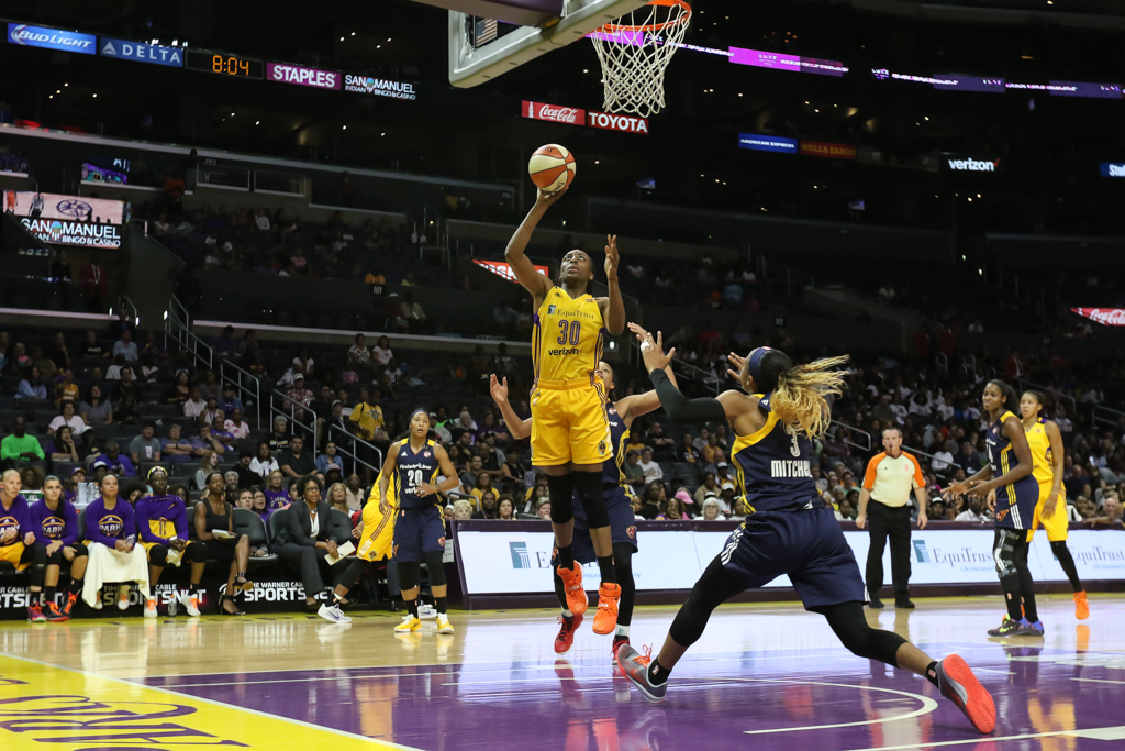 Nneka Ogwumike slipping past defense during Indiana Fever vs Los Angeles Sparks game at Staples Center in Los Angeles, Ca on July 6, 2016. (Photo by Jevone Moore/Full Image 360)