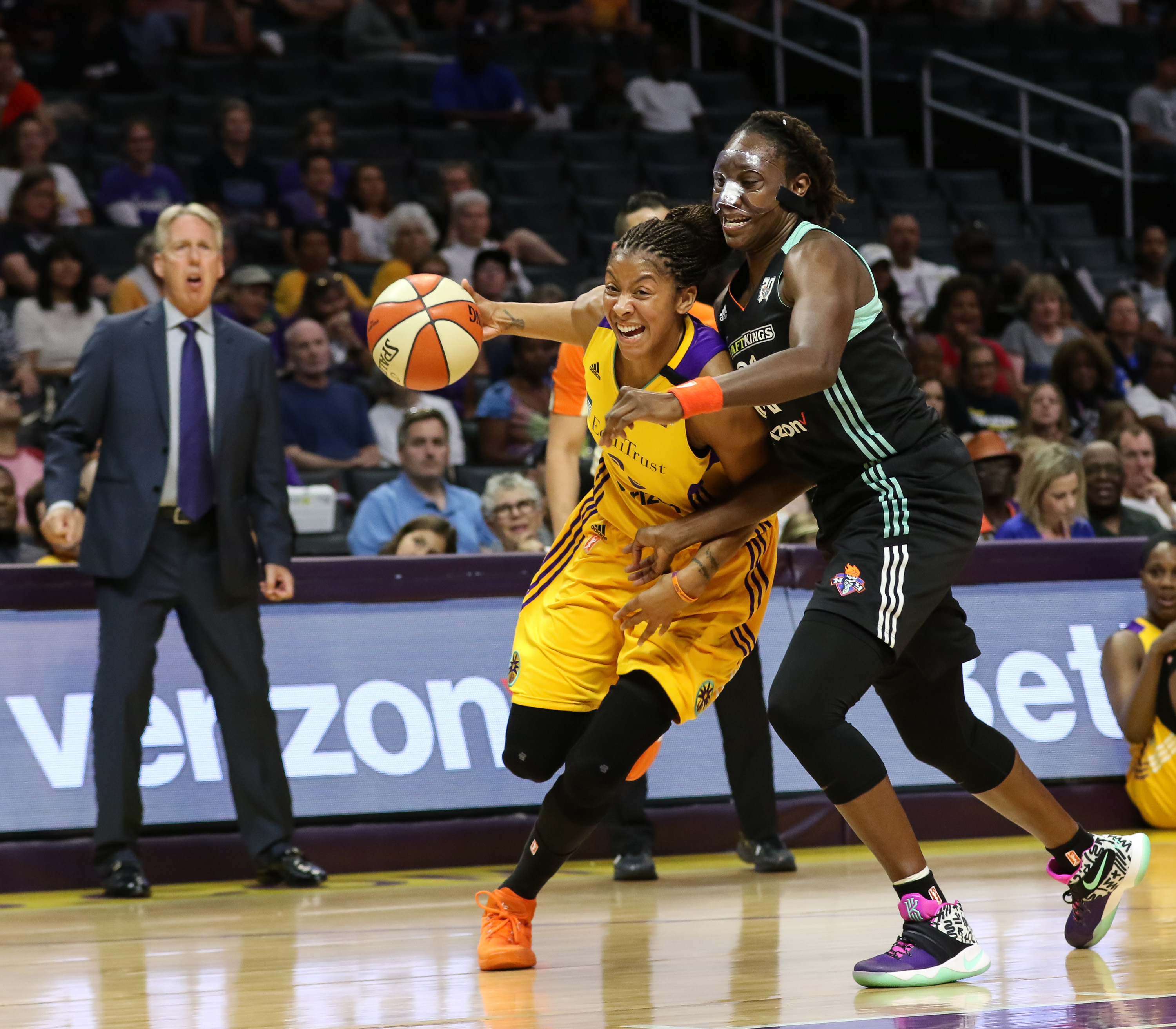 Candace Parker sliding by Tina Charles in first half of the New York Liberty vs Los Angeles Sparks game at Staples Center in Los Angeles, Ca on July 3, 2016. (Photo by Jevone Moore/Full Image 360)