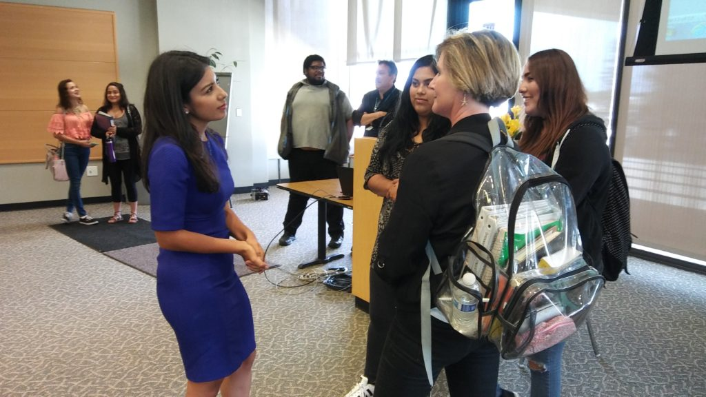 ABC7 Reporter Anabel Muñoz (L) conversing with presentation attendees on Thursday, September 22 at El Camino College in Torrance, Ca. (Photo by Jevone Moore / Full Image 360)
